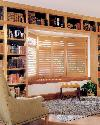Library Love Seat Area with custom cushion and Plantation Shutters in Light Colored Stained Wood-- Royal Palm Beach Florida