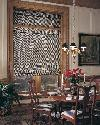 Woven Wood Roman Shades -- Flat version in dining room -- Lantana Florida