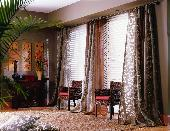 Puddled Drapery Panels and white wood blinds -- Boca Raton Florida