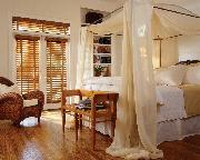 Palm Beach Gardens --Gorgeous Opulent Bedroom with Horizontal Wood Blinds