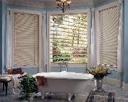 Horizontal Mini-Blinds add privacy and beauty to this traditional bathroom in Delray Beach Florida