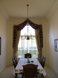 Arch treatment with medallions and Vertical Blinds -- Jupiter/Juno Beach Residence