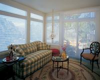 Silhouette shades and Luminette shades together complement one another in this Lake Worth Florida -- Florida room