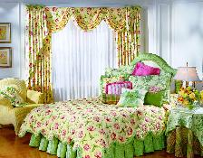 matching custom comforter bed skirt and drapery treatment with sheers make this very colorful and eye-catching bedroom in Boynton Beach Florida