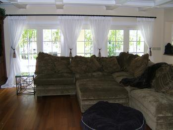 Tieback sheers drape with panels in Palm Beach Gardens home