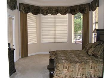 Swag Top Treatment with drapery panels and wooden window blinds -- Wellington Florida Residence
