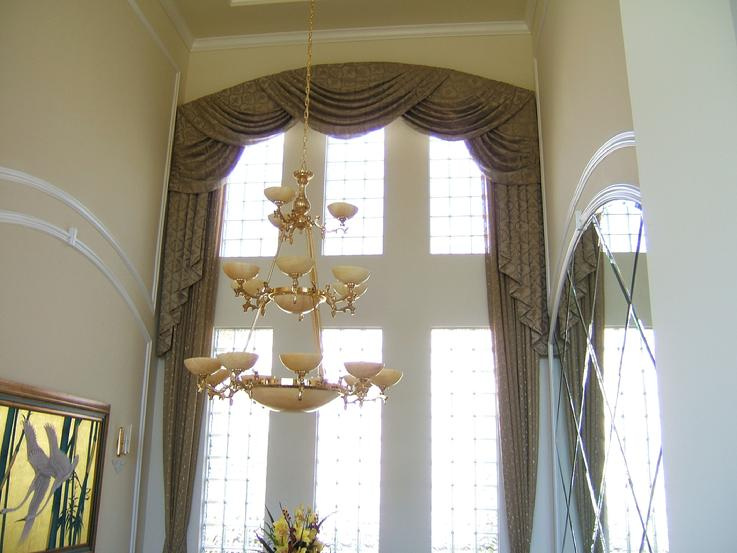 Arched Swag Window treatment width panels in Jupiter Country club, Florida
